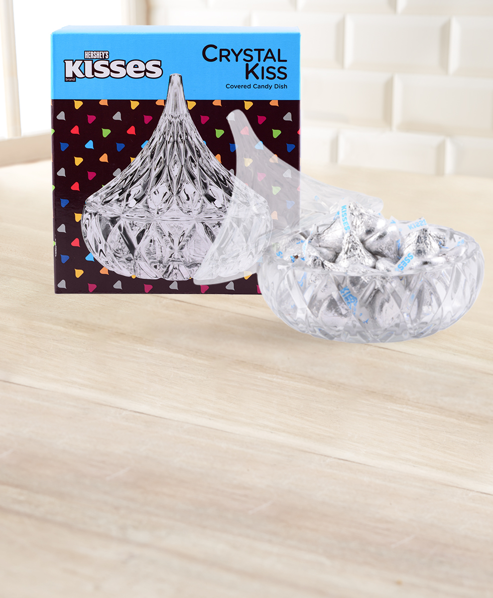 A HERSHEY KISSES Brand Crystal Kiss Covered Candy Dish along with its package