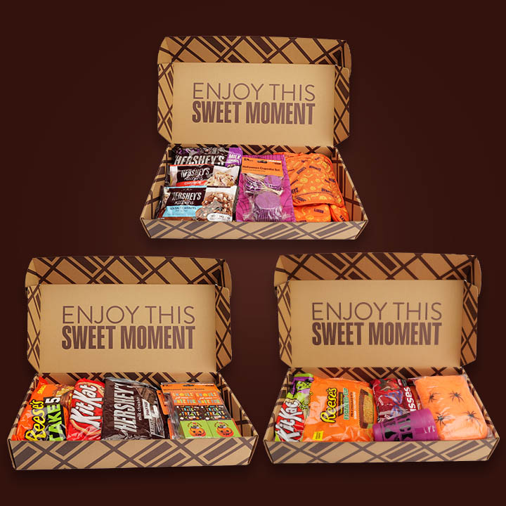 Three Halloween boxes, open to show contents